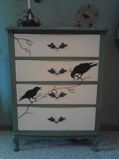 Old dresser was all white, paint base a green, drawers, a pale yellow, painted crows and branches.