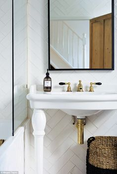'In the family bathroom the tiles are pretty ordinary, but laid in a herringbone pattern to add interest,' says Jane. For a similar basin, try Waterworks (waterworks.com). 'I chose unvarnished brass taps, so they have tarnished naturally and look authentically old,' she explains. For similar taps, try Catchpole & Rye (catchpoleandrye.com)