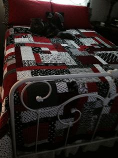 Red, white and black quilt. He looks comfortable. Peace, Robert from nancysfabrics.com