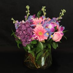 Pink Gerber Daisy's, Purple Hydrangea, and Orchid's $75