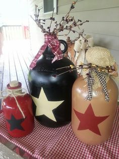 Old glass jugs...painted Americana