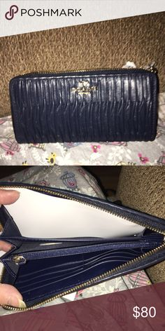 NWOT COACH WALLET New Coach wallet Navy Blue in color with gold accents. It has 12 slots for cards, 1 zipper pocket in the center and 2 pockets for cash/receipts Coach Bags Wallets