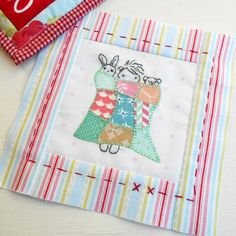 The Splendid Sampler Block no. 7 - Snug as a Bug.  Designed by Amy Sinibaldi.  Applique and embroider.