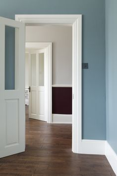 Foreground walls in Farrow & Ball's Oval Room Blue. Hallway walls in Brinjal and Cornforth White Modern Emulsion. Woodwork in Wimborne White. bath Oval room Blue, panelling pale putty colour, walls - cornforth white OR purbeck stone. Oval Room Blue, Blue Rooms, Farrow And Ball Paint, Farrow Ball, Farrow And Ball Living Room, Farrow And Ball Kitchen, Living Rooms, Baseboard Styles, Colores Paredes