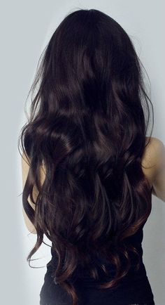 Long dark wavy hair almost black. A very pretty shiny dark brown! https://www.facebook.com/shorthaircutstyles/posts/1720564751567298