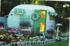 Love the little window awnings.My Glamper can be a part of my garden decoration until i go glamping!
