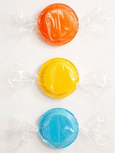 """Colored paper plates wrapped in cellophane. Brilliant for kids birthday decor  """"candy land theme"""""""