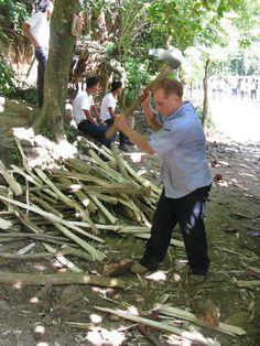 Aladino chopping up Inga firewood for the kitchen.