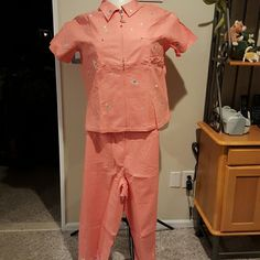 Quacker Factory cocktail embroidered capri set Linen rayon spandex blend Capri and zippered short sleeve top set. Embroidery is a variety of multi colored cocktails. Top has zippered front with cocktail zipper puller, two breast Pockets with rivet accents comma and rhinestone embellishment. Capris have zipper fly two front and two back pockets with elastic waist at the back. Capris are embroidered around the bottom and have a 22 inch inseam. Brand new with tags and never worn. Quacker…