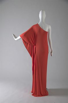 Evening gown, c. 1976 Silk jersey  Born in Des Moines, Iowa, Roy Halston Frowick came to Chicago to attend the School of the Art Institute. He opened a millinery studio in the early 1950s and later moved to New York to launch his dressmaking career. Halston soon became known for his classical designs in silk jersey and Ultrasuede.  This gown is one of  more than 60 couture pieces featured in the exhibition Chic Chicago: Couture Treasures from the Chicago History Museum.  © Chicago History…