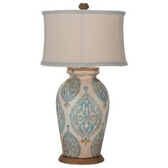 """The Jaipur table lamp gains inspiration from traditional Indian block prints in subtle shades of blue. A classic rounded shade tops the handpainted, vase-inspired base, ideal in a living room or atop a bedside table. 17""""W x 17""""D x 31""""H. Terra cotta, metal. Antique white, original art finish. Accepts one 100W bulb (not included). Wipe with soft, dry cloth to clean."""