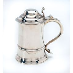 A GEORGE III SILVER TANKARD, THOMAS WHIPHAM AND CHARLES WRIGHT, LONDON, 1769 of plain tapered cylindrical form with simple skirt foot, applied reeded girdle, scroll handle with scroll thumbpiece to domed lid