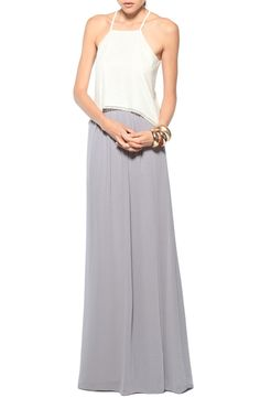A delicate lace top paired with a flowy maxi skirt is a classy and elegant alternative to a dress.