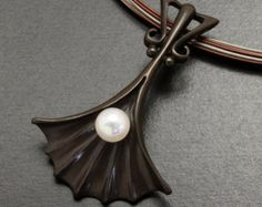 Ginkgo pendant with a cultured pearl and Japanese patina