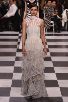 DIOR SPRING/SUMMER 2018- SPIDERMAN NECKLICE OVER TUNIC OVER RUFFLED GOWN BOTTOM-  DIOR ARE YOU STUPID??? CHOOSE A FLOW NOT A COLLISION !!!- LIVESSHOP247nyc