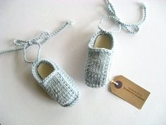 Hand knit baby booties with ankle ties. Blue merino wool.