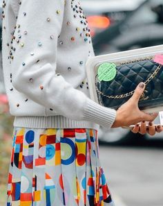 Black Chanel quilted purse, Chanel skirt, embellished sweater
