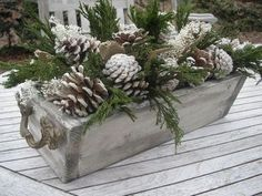 Spray pine cones with a little white spray paint to add a wintry touch! Pine cones and greenery in sewing drawer for an Upcycled recycled Christmas decor look. After Christmas, Noel Christmas, Outdoor Christmas, Country Christmas, Christmas Wreaths, Christmas Crafts, Coastal Christmas, Christmas Planters, Christmas Arrangements