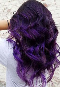 Favorite dark purple hair colors are really awesome for everyone. Here you can see most amazing trends of purple hair colors for long wavy and curly hair in 2018. We've compiled here a list of gorgeous purple shades for those ladies who love to wear purple colored hair. Browse here and see the cutest purple colors.
