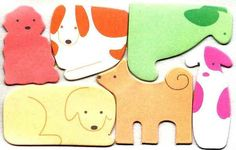 A pack of sticky notes shaped like puppies.