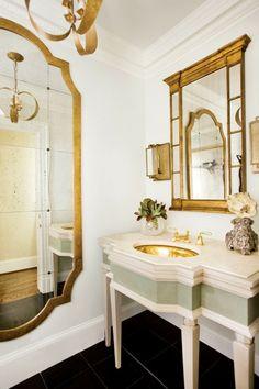 Gold trim, white walls, gold sink