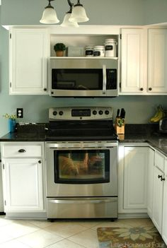 Kitchen---I like the shelf above the microwave. Remove our doors and do the same. Little House of Four blog.