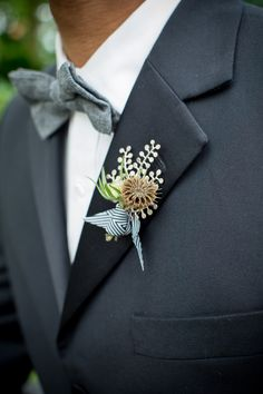 unique boutonniere //  photo by JennaBeth Photography, styling by Locally Grown Weddings http://ruffledblog.com/black-and-white-wedding-ideas