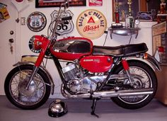 Here's a first year example of the Yamaha Grand Prix, also known as the YR-1. It was the biggest bike in their line up, and Yamaha's first 350cc production engine. Despite the relative diminutive size, this bike was highly competitive with British 650s. Thanks to a chassis and engine that was suitable from road racing from the factory, it was a great bike that evolved into iconic 2-stroke Yamahas like the R5, RD350, and more.
