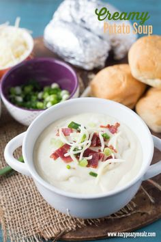 A creamy baked potato soup, made in the blender, then heated on the stove top, topped with salty bacon, chopped chives, and grated cheese! Creamy Potato Soup - Eazy Peazy Mealz