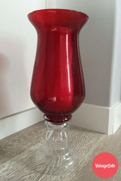 Decorative glass candle holder with mixture of deep red and clear glass. Perfect for decorating your living room. Measures 14 inches tall. Asking $10. Find this and other great deals locally in your community on www.varagesale.com