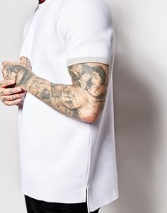 http://www.asos.com/ASOS/ASOS-T-Shirt-In-Neoprene-With-Stepped-Hem-Skater-Fit/Prod/pgeproduct.aspx?iid=4871303&WT.ac=rec_viewed&CTAref=Recently+Viewed