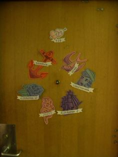 Old school ink door-decs. Print out different designs. Simple name banners. Different on every door.