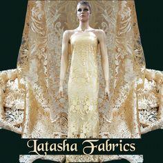 Tonal embroidery Fabric on tulle fabric exclusively available at Latasha Haute Couture Fabrics  Latasha Haute Couture Fabrics.  Shop no. 4, pankaj hill co op hsg soc. Ltd., Ambedkar Road, Khar (W), near ambedkar statue. Mumbai 52 Ph - 022 26001048