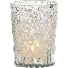 Silver Mercury Glass Votive Wholesale (medallion design).  3.25 inches in diameter x 4 inches high. The vintage metallic finish of our mercury glass is reflective and shimmery, enhancing candlelight. Perfect for any celebration.