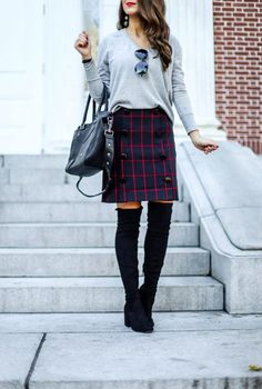 Grey Sweater and Plaid Skirt..Plaid Skirt. Work Wear. Outfits for Work. Skirts for Work . Plaid Outfits. Plaid for Fall. #plaid #skirts Black Over the Knee Boots.