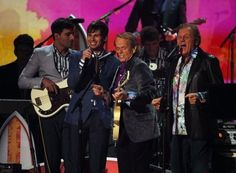 Foster The People perform with the Beach Boys at the 2012 Grammy Awards
