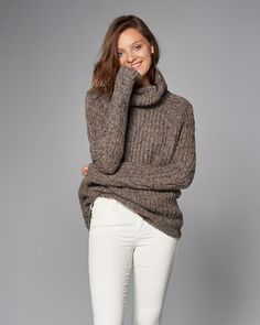 A cozy and classic staple featuring a wool-blend, turtleneck design, allover…