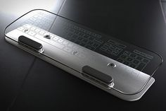 Glass Multi-Touch Keyboard & Mouse ($350) uses infrared LEDs placed at the edge of the glass