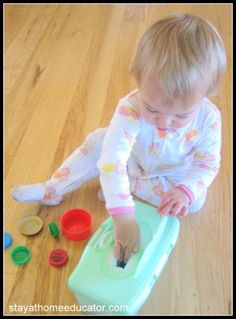Fine motor skill practice--bottle caps in and out of an empty wipes box.