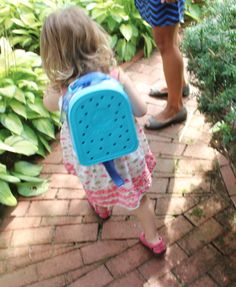 Our Women's Carliana Peep Toe Flat and Crocband™ Backpack- a perfect playdate combo.