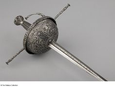 Cup-hilt rapier Juanes de Tolledo Spain probably 3rd quarter of 17th century Steel, pierced, chased and chiselled Length: 122 cm Width: 2.38 cm Weight: 1 kg Inscription: 'J.V.A.N.E.Z. .D.E. .T.O.L.L.E.D.O' Incised mark A656 European Armoury II