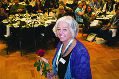 Rebecca Dunn of Cooperative Fund of New England accepted the rose honoring the Fund's 40 years. CCMA 2016