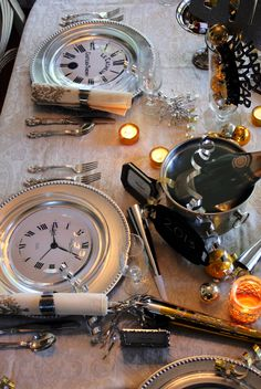 Place printed clock faces between charger and clear glass plates for a festive New Year's place setting.