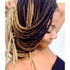 dark brown to light honey blonde ombre dreadlocks. skinny, smooth, and long natural locs.
