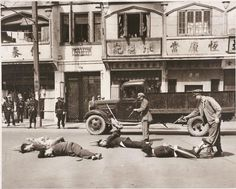 Shanghai policeman executing communists agents before the city fell to Chinese communist troops.  May 16, 1949 [956x768]