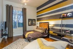 Eclectic Guest Bedroom with Wall sconce, flush light, Built-in bookshelf, Hardwood floors