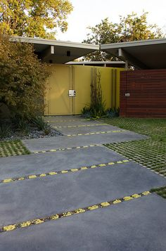 Garden by Bernard Trainor, good example of permeable driveway surface to hold water on site
