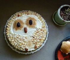 Owl cake - Sub nuts for white chocolate buttons, and make eyes out of half oreos.