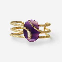 Isharya celebrates the Year of the Snake with the updated Serpent Druzy wire cuff. Simmering shades of purple represent mystery, with a stylish fashionable edge. Our snake design wraps around a unique druzy stone, and cubic zirconia adds a touch of sparkle. Pair it cuff with a vintage t-shirt and leather pants for a look that is on trend.  Handcrafted with purple druzy, cz, black enamel, and 18k gold plated brass.