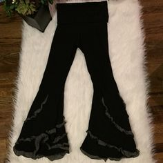 Caraucci  flare yoga pants✌️ Caraucci handmade yoga wear.  These are black with decorated ruffle legs.  Can be folded up or down to help hide any problem areas of cellulite.  Super lightweight and comfortable.  Like new condition. Caraucci Pants Boot Cut & Flare